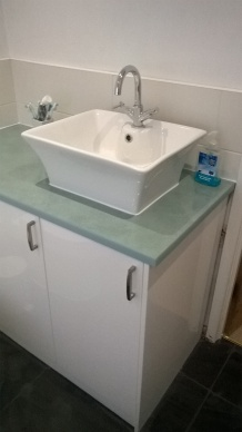 Bespoke cabinet, with basin fitted and tiling