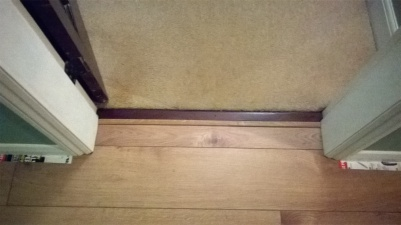 Traditional door threshold - after, with new laminate